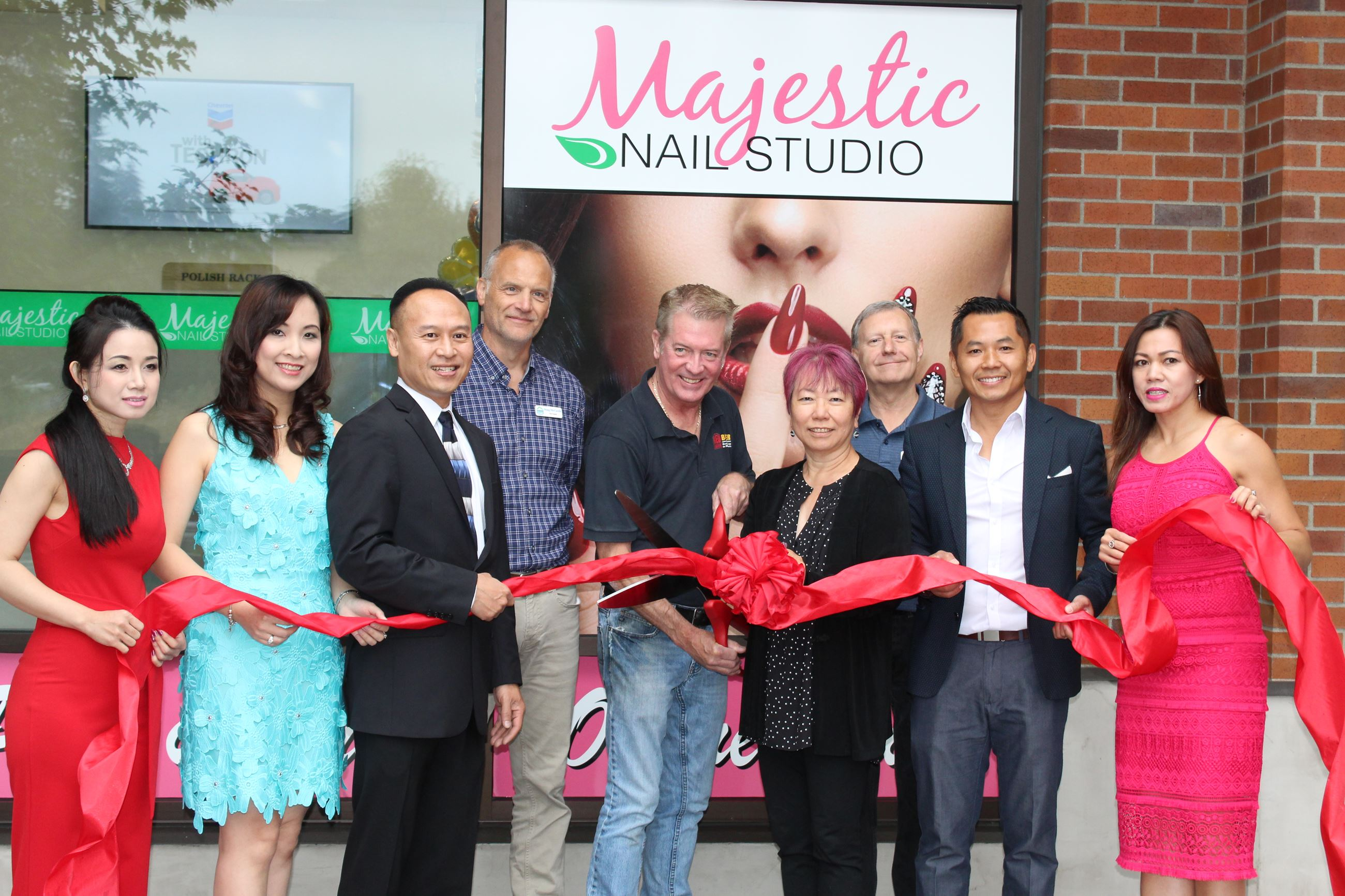 Nine people at Majestic Nail Studio ribbon cutting
