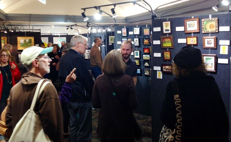 Friday reception lots of people viewing art
